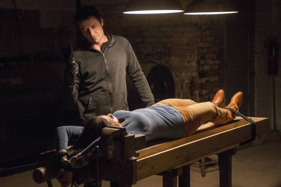 Photo - This TV publicity image released by Fox shows James Purefoy as serieal killer Joe Carroll confronting his next victim in the