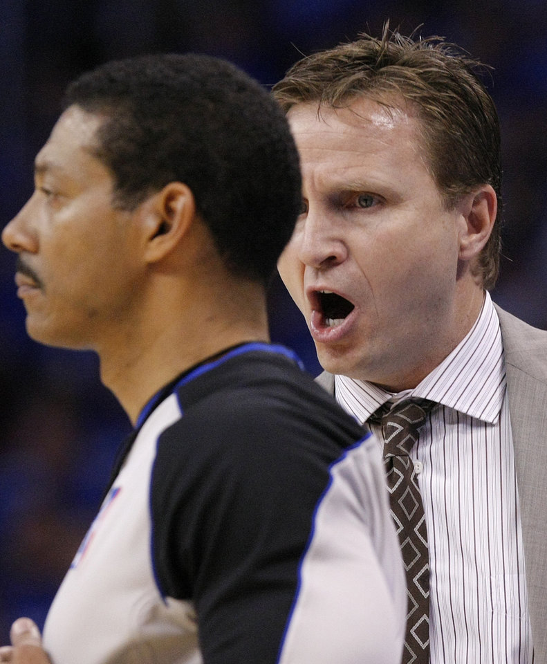 Photo - Coach Scott Brooks yells at the official about a call during game two of the Western Conference semifinals between the Memphis Grizzlies and the Oklahoma City Thunder in the NBA basketball playoffs at Oklahoma City Arena in Oklahoma City, Tuesday, May 3, 2011. Photo by Chris Landsberger, The Oklahoman