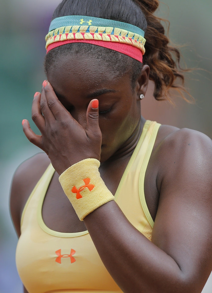 Photo - Sloane Stephens, of the U.S, wipes her face as she plays Romania's Simona Halep during their fourth round match of  the French Open tennis tournament at the Roland Garros stadium, in Paris, France, Monday, June 2, 2014. (AP Photo/Michel Spingler)