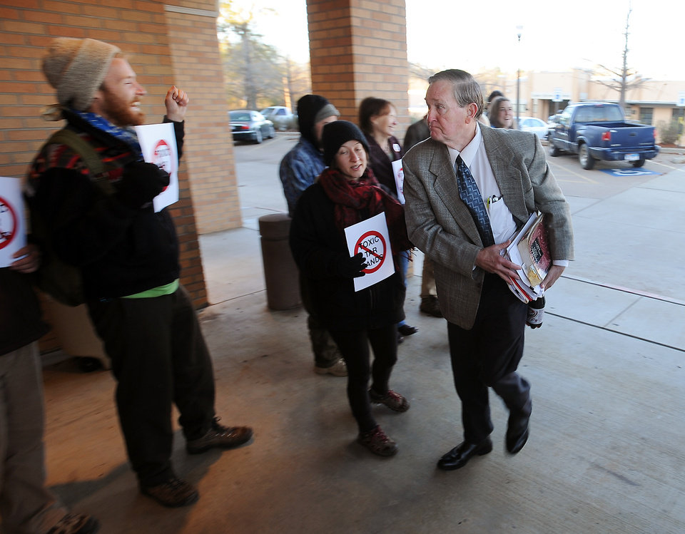 Michael Bishop, right, receives cheers and other expressions of support from XL Pipeline opponents as he makes his way to the Nacogdoches County Courthouse in Nacogdoches,  Texas, on Thursday, Dec. 13, 2012, for an emergency hearing.  TransCanada is building part of an oil pipeline designed to carry tar sands oil from Canada to the Gulf Coast. The property rights dispute is the latest legal battle to plague a project that has encountered numerous obstacles nationwide. Texas landowner Michael Bishop obtained a temporary restraining order from Sinz last Friday, arguing that TransCanada lied to Texans when it said it would be using the Keystone XL pipeline to transport crude oil. (AP Photo/The Daily Sentinel, Andrew D. Brosig) MANDATORY CREDIT