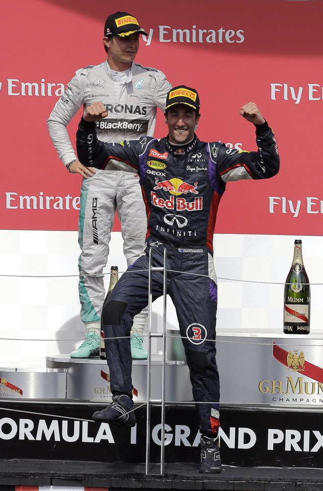 Photo - Red Bull driver Daniel Ricciardo, from Australia, celebrates in front of Mercedes driver Nico Rosberg, from Germany, after winning the Canadian Grand Prix Sunday, June 8, 2014, in Montreal. Rosberg finished second. (AP Photo/David J. Phillip)