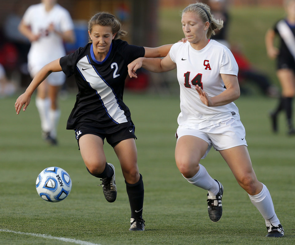 Photo - Deer Creek's Ashton England, left, and Brooklynn Speis chase down the ball during the Class 5A girls state soccer championship between Deer Creek and Carl Albert in Norman, Okla., Saturday, May 17, 2014. Photo by Bryan Terry, The Oklahoman
