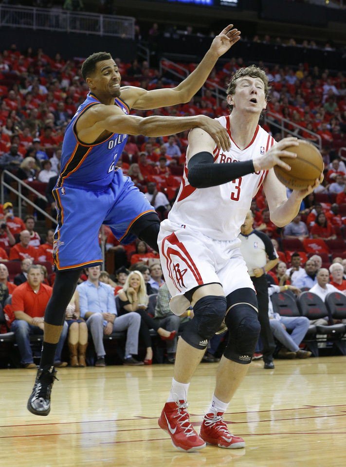 Photo - Houston's Omer Asik (3) goes up for a lay up as Oklahoma City's Thabo Sefolosha (2) defends during Game 4 in the first round of the NBA playoffs between the Oklahoma City Thunder and the Houston Rockets at the Toyota Center in Houston, Texas, Monday, April 29, 2013. Photo by Bryan Terry, The Oklahoman
