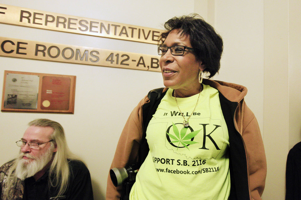 Photo - Arlene Barnum, Stewart, wearing a T-shirt in support of Senate Bill 2116 as people gather in the fourth floor rotunda to lobby legislators at the state Capitol in Oklahoma City Wednesday, Feb. 12, 2014. Supporters converged on the state Capitol to personally lobby their legislators to reform Oklahoma's strict marijuana laws during