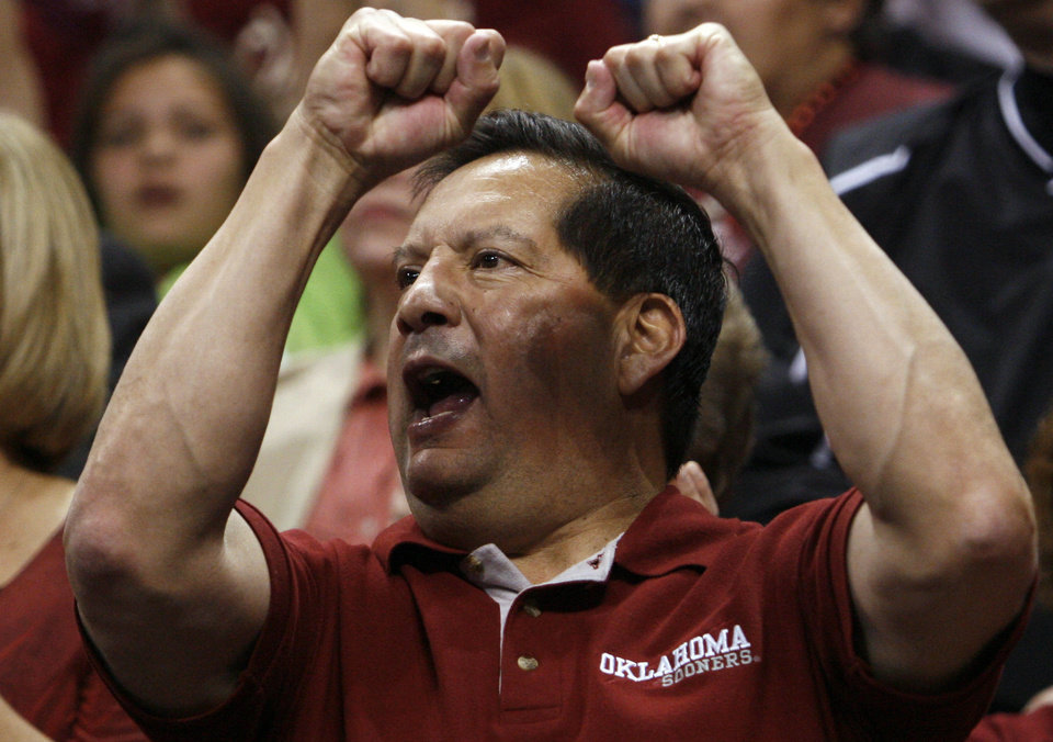 Photo - Bruce Hernandez of Edmond cheers as the University of Oklahoma (OU) defeats Purdue 74-68 in the NCAA women's basketball regional tournament finals at the Ford Center in Oklahoma City, Okla., on Tuesday, March 31, 2009.  Photo by Steve Sisney, The Oklahoman