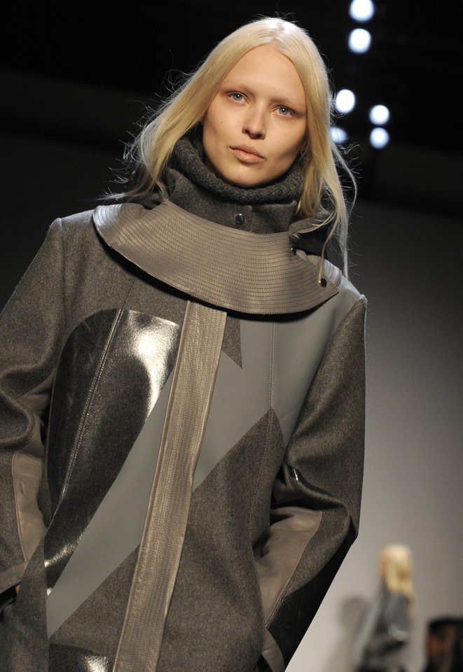 Photo - The Helmut Lang Fall 2013 collection is modeled during Fashion Week, Friday, Feb. 8, 2013, in New York. (AP Photo/Louis Lanzano)