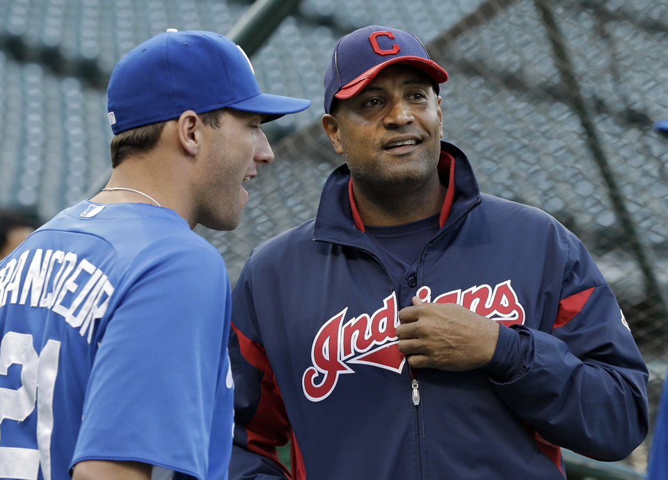 Photo -   Cleveland Indians interim manager Sandy Alomar, Jr., right, talks with Kansas City Royals right fielder Jeff Francoeur (21) during batting practice before a baseball game Friday, Sept. 28, 2012, in Cleveland. Alomar takes over for Manny Acta who was fired Thursday. (AP Photo/Mark Duncan)