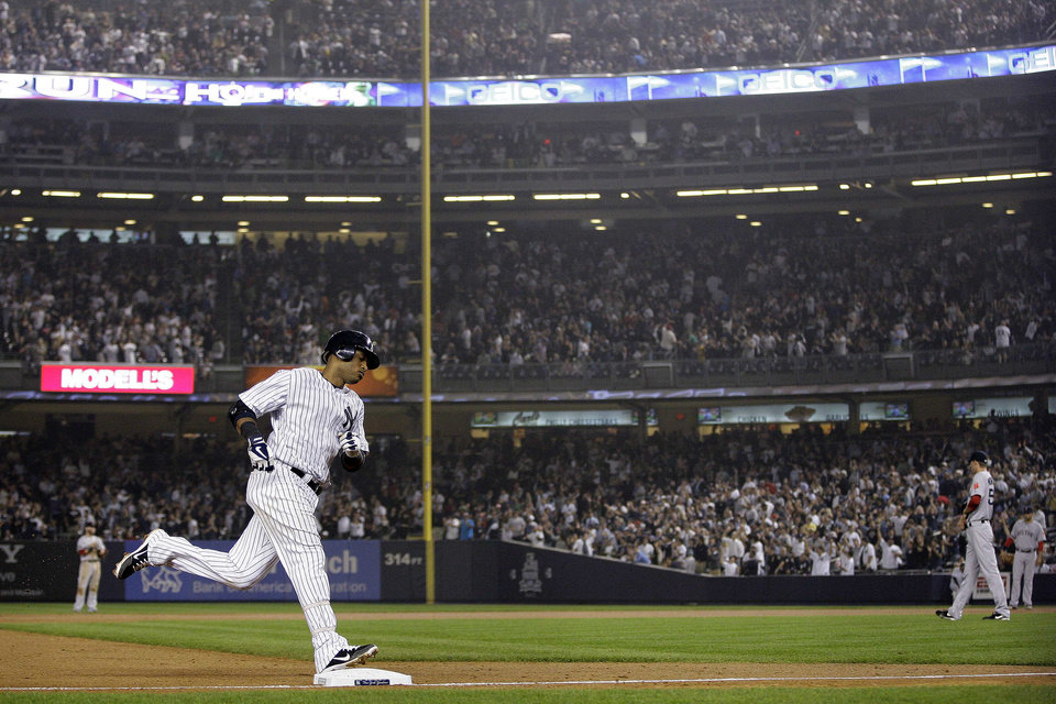 Photo -   New York Yankees' Robinson Cano (24) runs the bases after hitting a two-run home run during the fifth inning of a baseball game as Boston Red Sox relief pitcher Clayton Mortensen, right, looks away, Wednesday, Oct. 3, 2012, in New York. (AP Photo/Frank Franklin II)