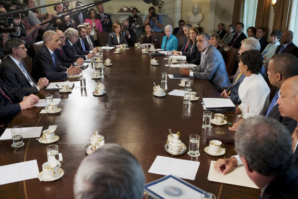 Photo - President Barack Obama meets with his cabinet members including Attorney General Eric Holder, across from the president, Tuesday, July 1, 2014, in the Cabinet Room of the White House in Washington. (AP Photo/Jacquelyn Martin)