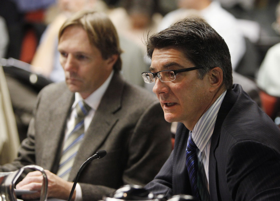 Matthew Lepore, right, Director of the Oil & Gas Conservation Commission and Jim Milne, Environmental Manager, testify on ground water issues at a meeting of the Colorado Oil and Gas Conservation Commission in Denver on Wednesday, Nov. 14, 2012. Groundwater tests could help show whether water has or hasn't been contaminated by drilling. (AP Photo/Ed Andrieski)