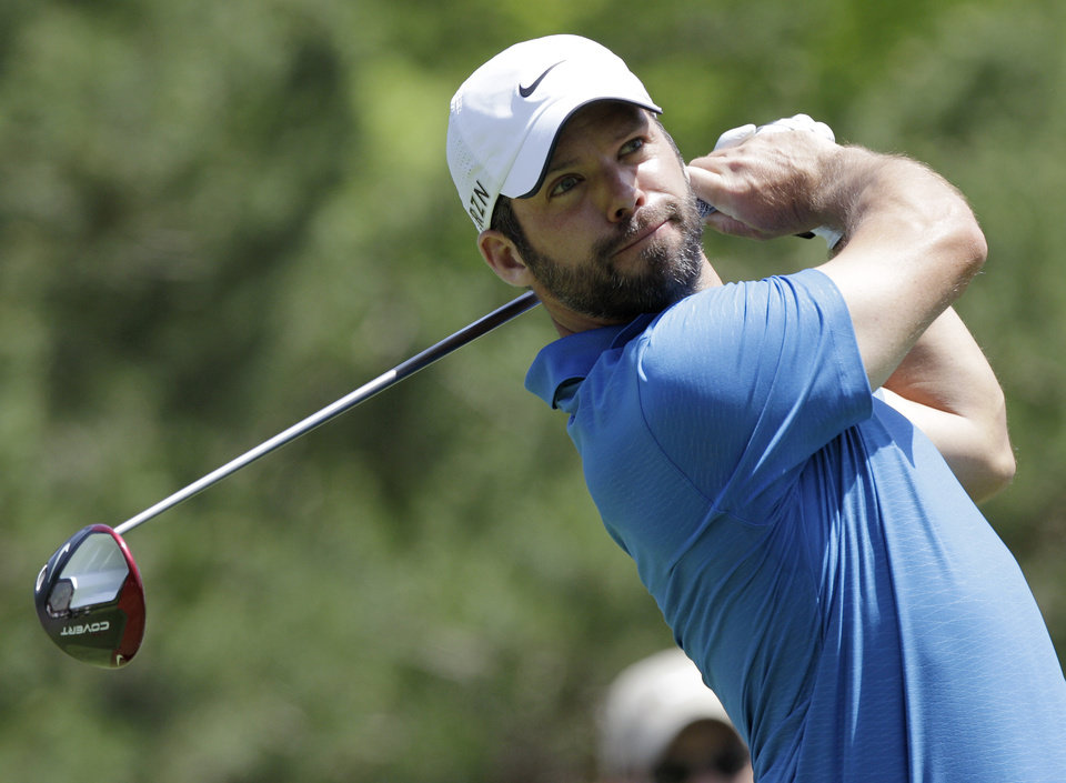 Photo - Paul Casey tees off on the 15th hole during the second round of the Memorial golf tournament Friday, May 30, 2014, in Dublin, Ohio. (AP Photo/Jay LaPrete)