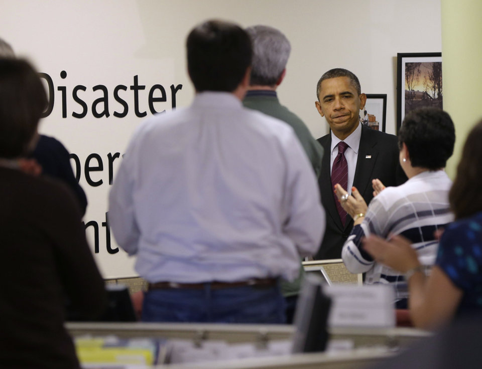 President Barack Obama receives applauds by workers during the his visit to the Disaster Operation Center of the Red Cross National Headquarter to discuss superstorm Sandy, Tuesday, Oct. 30, 2012, in Washington. (AP Photo/Pablo Martinez Monsivais)