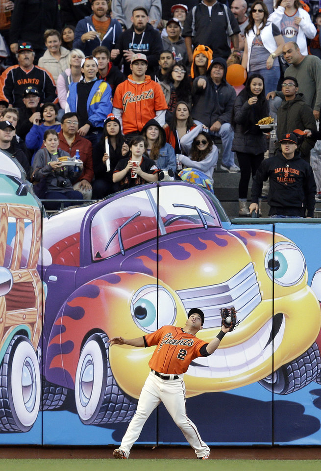 Photo - San Francisco Giants left fielder Juan Perez catches a ball hit by New York Mets' Andrew Brown in the second inning of a baseball game Friday, June 6, 2014, in San Francisco. (AP Photo/Ben Margot)