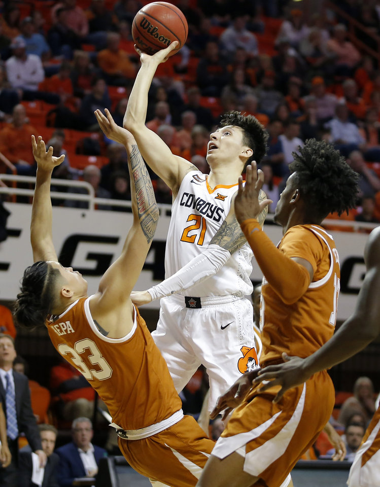 Photo - Oklahoma State's Lindy Waters III (21) is called for a foul as he collides with Texas' Kamaka Hepa (33) during an NCAA basketball game between the Oklahoma State University Cowboys (OSU) and the Texas Longhorns at Gallagher-Iba Arena in Stillwater, Okla., Wednesday, Jan. 15, 2020. [Bryan Terry/The Oklahoman]