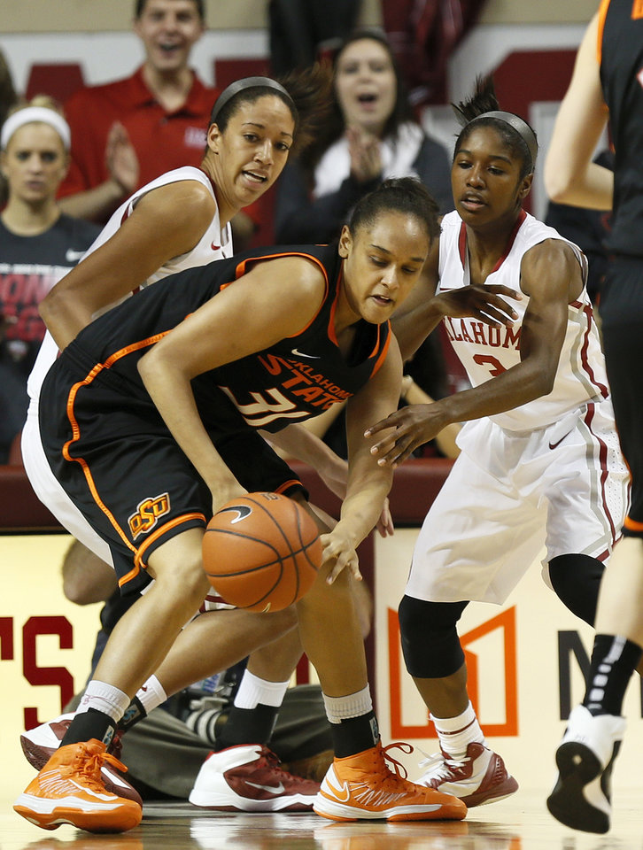 Photo - Oklahoma State's Kendra Suttles (31) tries to get control of the ball in front of Oklahoma's Nicole Griffin (4), left, and Oklahoma's Aaryn Ellenberg (3) in the second half during a women's Bedlam college basketball game between the Oklahoma State University Cowgirls (OSU) and the University of Oklahoma Sooners (OU) at Lloyd Noble Center in Norman, Okla., Saturday, Feb. 1, 2014. OU won, 81-74. Photo by Nate Billings, The Oklahoman