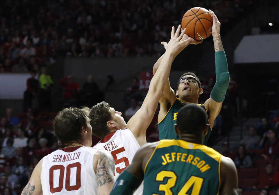 Photo - Baylor's Isaiah Austin (21) shoots in front of Oklahoma forward Tyler Neal (15), forward Ryan Spangler (00) and teammate Cory Jefferson (34) in the first half of an NCAA college basketball game in Norman, Okla., Saturday, Feb. 8, 2014. (AP Photo/Sue Ogrocki)