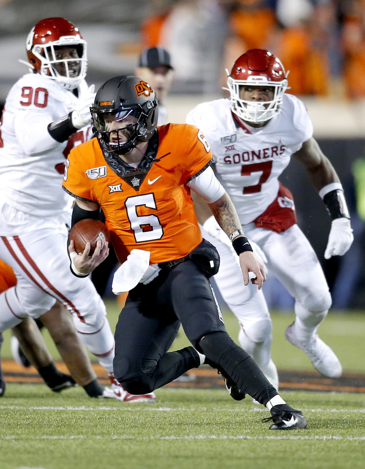 Photo - Oklahoma State's Dru Brown (6) rushes in the third quarter during the Bedlam college football game between the Oklahoma State Cowboys (OSU) and Oklahoma Sooners (OU) at Boone Pickens Stadium in Stillwater, Okla., Saturday, Nov. 30, 2019. OU won  34-16. [Sarah Phipps/The Oklahoman]