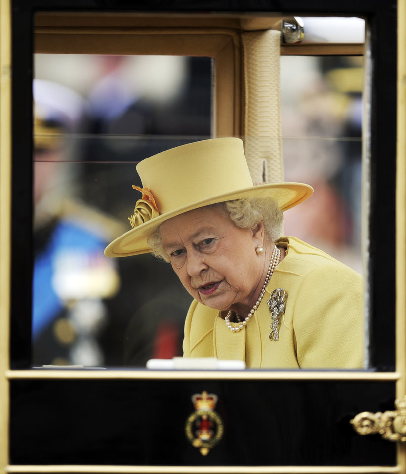 Photo - Britain's Queen Elizabeth II looks out of her carriage outside Westminster Abbey after the Royal Wedding for Britain's Prince William and his wife Kate, Duchess of Cambridge in London Friday, April, 29, 2011. (AP Photo/Martin Meissner) ORG XMIT: RWMG167