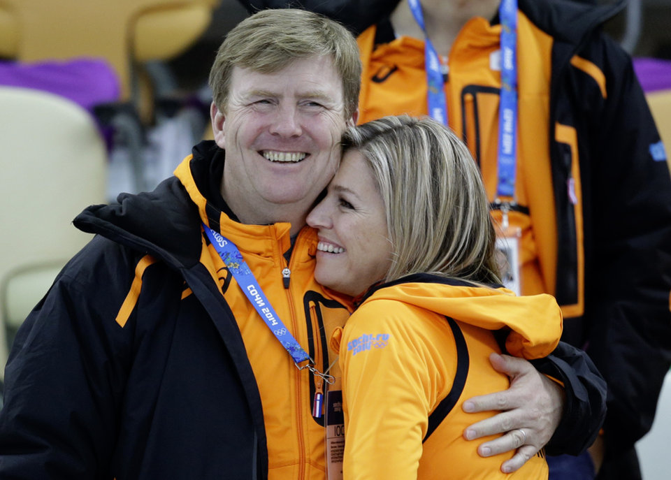 Photo - Dutch King Willem-Alexander and Queen Maxima hug each after country skater Margot Boer won a bronze in the  women's 500-meter speedskating race at the Adler Arena Skating Center at the 2014 Winter Olympics, Tuesday, Feb. 11, 2014, in Sochi, Russia. (AP Photo/Patrick Semansky)