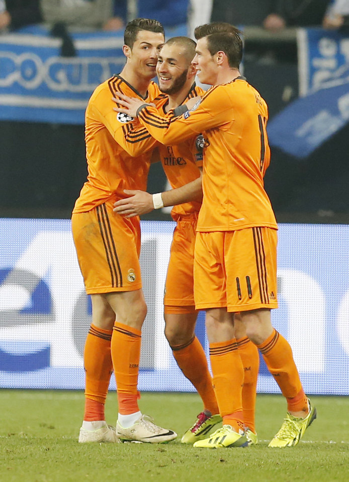 Photo - Real's Cristiano Ronaldo, Real's Karim Benzema and Real's Gareth Bale, from left, celebrate their team's fourth goal during the Champions League round of the last 16 first leg soccer match between Schalke 04 and Real Madrid in Gelsenkirchen, Germany, Wednesday, Feb.26,2014. (AP Photo/Frank Augstein)