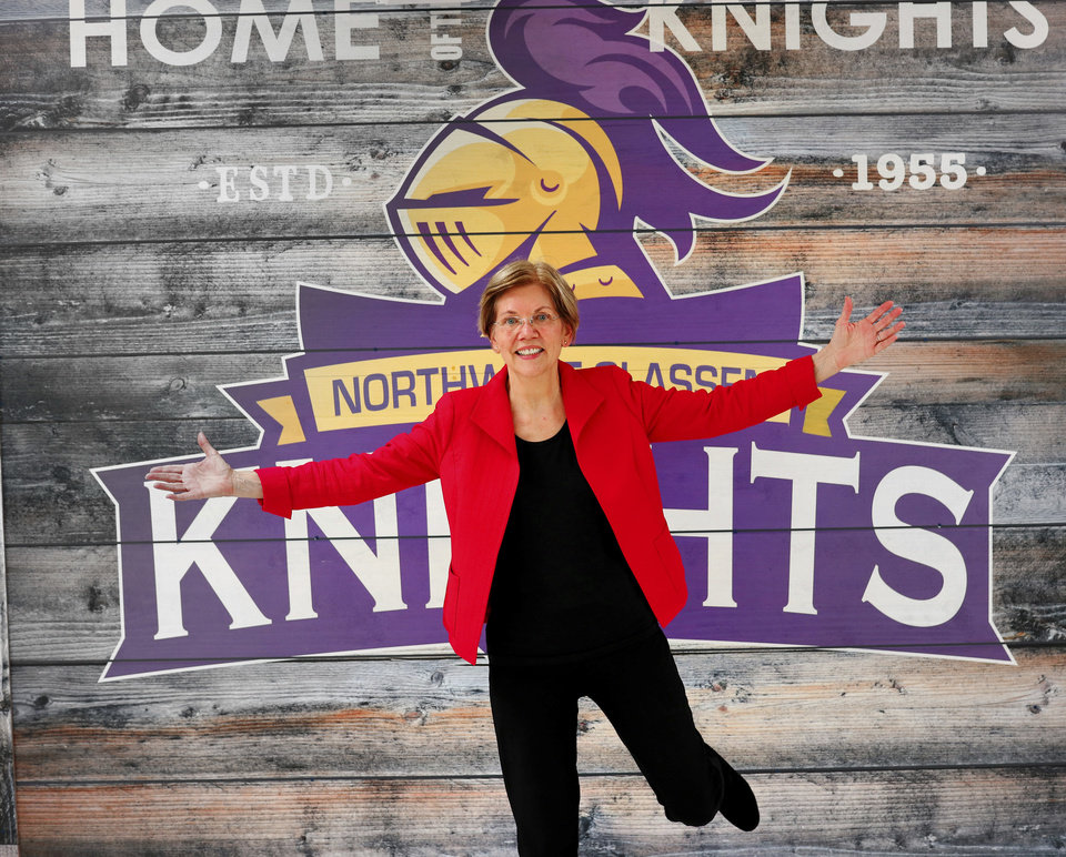 Photo - U.S. Sen. Elizabeth Warren poses by her former high school's mascot logo at Northwest Classen High School in Oklahoma City on Saturday, Sept. 22, 2018. Warren, Class of '66, was the main speaker at the American Federation of Teachers education rally at the school. (Doug Hoke/The Oklahoman via AP)