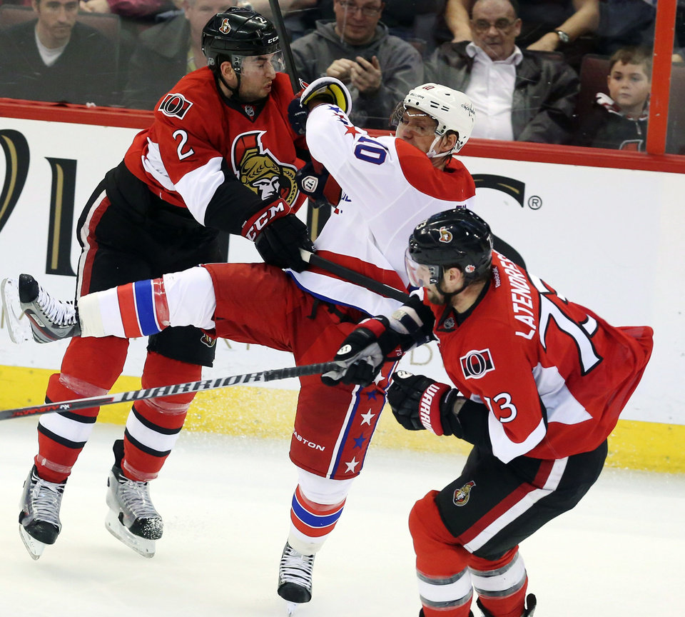 Photo - Washington Capitals' Martin Erat (10) is checked by Ottawa Senators' Jared Cowen (2) during the second period of their NHL hockey game in Ottawa, Ontario, Thursday, April 18, 2013. (AP Photo/The Canadian Press, Fred Chartrand)