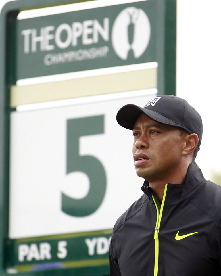 Photo - Tiger Woods of the US looks down the 5th fairway prior to teeing off during a practice round ahead of the British Open Golf championship at the Royal Liverpool golf club, Hoylake, England, Tuesday July 15, 2014. The British Open starts on Thursday July 17. (AP Photo/Peter Morrison)