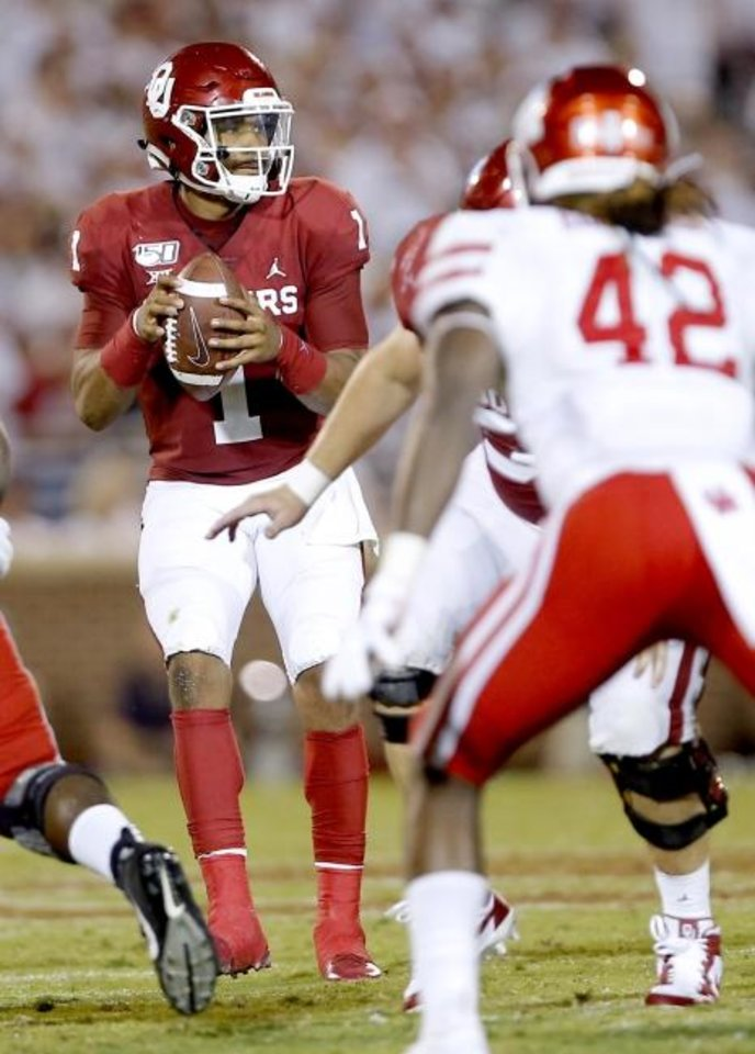 Photo -  Jalen Hurts completed 20 of 23 passes for 332 yards and three touchdowns in OU's win against Houston. [Sarah Phipps/The Oklahoman]