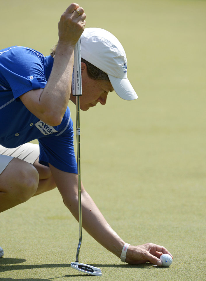 Photo - Catriona Matthew, of Scotland, places her ball before putting on the eighth hole in the second round of the Airbus LPGA Classic golf tournament at Magnolia Grove on Friday, May 23, 2014, in Mobile, Ala. (AP Photo/G.M. Andrews)