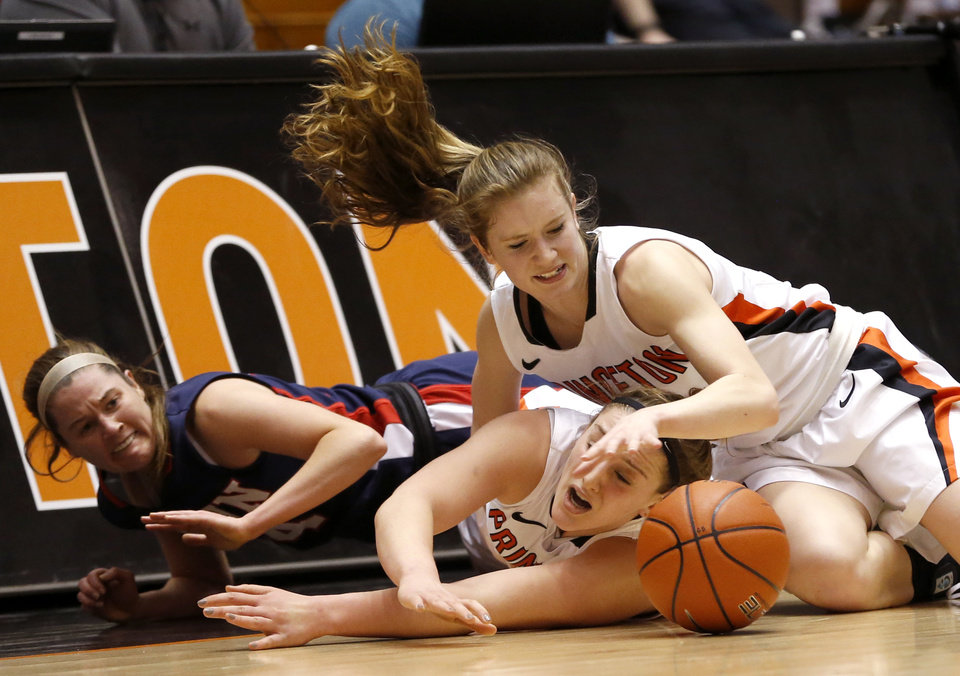 Photo - Penn guard Meghan McCullough, left, collides with Princeton guards Annie Tarakchian, center, and Blake Dietrick while competing for the ball during the first half of an NCAA college basketball game, Tuesday, March 11, 2014, in Princeton, N.J. (AP Photo/Julio Cortez)