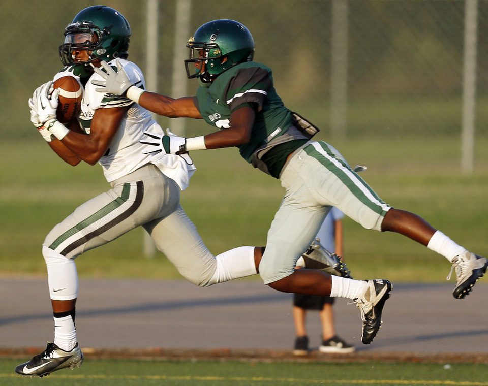 Photo - Norman North's Nick Basquine (5) makes a touchdown catch against Edmond Santa Fe's Quinzell Jones (2) during a football scrimmage at Edmond Santa Fe High School in Edmond, Okla., Thursday, Aug. 22, 2013. Photo by Nate Billings, The Oklahoman