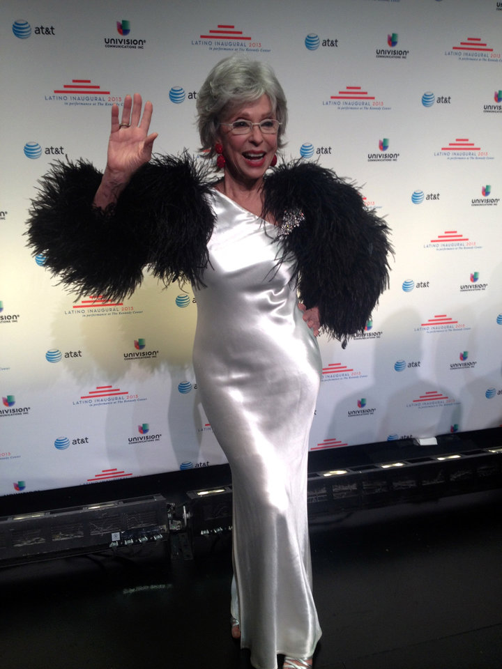 Actress Rita Moreno waves on the red carpet of the Latino Inaugural 2013 ball at the Kennedy Center in Washington, Sunday, Jan. 20, 2013. (AP Photo/Brett Zongker)