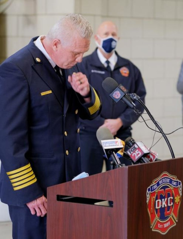 Photo -  Oklahoma City Fire Chief Richard Kelley chokes back tears while talking Monday about last week's death of Maj. Andy Davis.  The 20-year veteran died from COVID-19 on Christmas Eve. [DOUG HOKE/THE OKLAHOMAN]