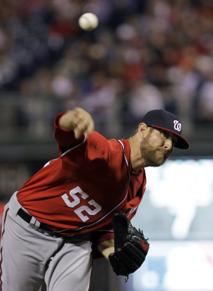 Photo - Washington Nationals pitcher Ryan Mattheus throws in the fifth inning of a baseball game against the Philadelphia Phillies, Saturday, May 3, 2014, in Philadelphia. (AP Photo/Laurence Kesterson)
