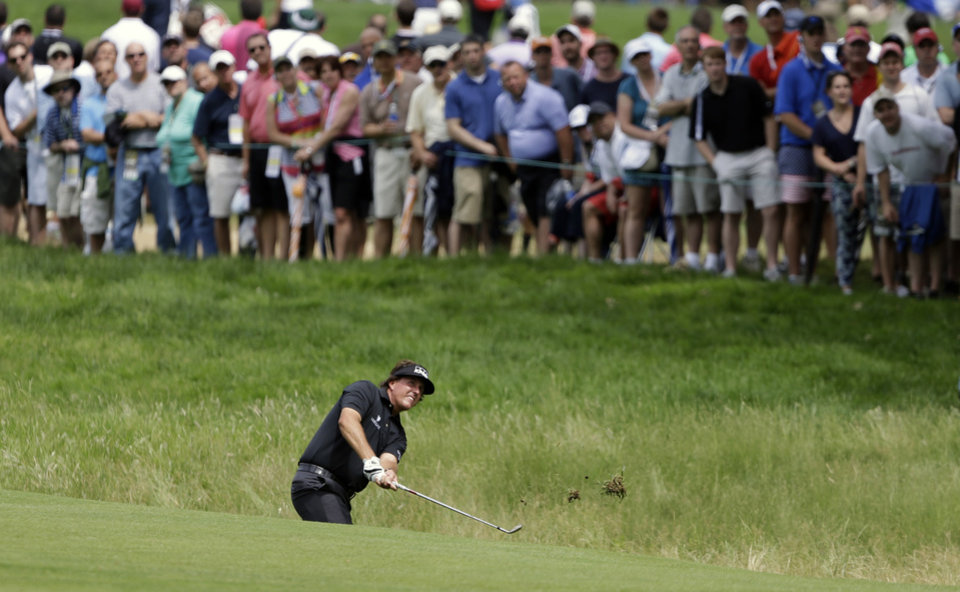 Photo - Phil Mickelson hits on the fifth hole during the first round of the U.S. Open golf tournament at Merion Golf Club, Thursday, June 13, 2013, in Ardmore, Pa. (AP Photo/Darron Cummings)
