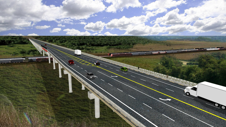 Photo -  This computer-generated rendering shows what the new US-77 bridge linking Purcell and Lexington will look like once it is completed in about two years. The replacement bridge will be four lanes, with a left turn lane at the intersection with Canadian Avenue in Purcell. [Rendering provided by Oklahoma Department of Transportation]