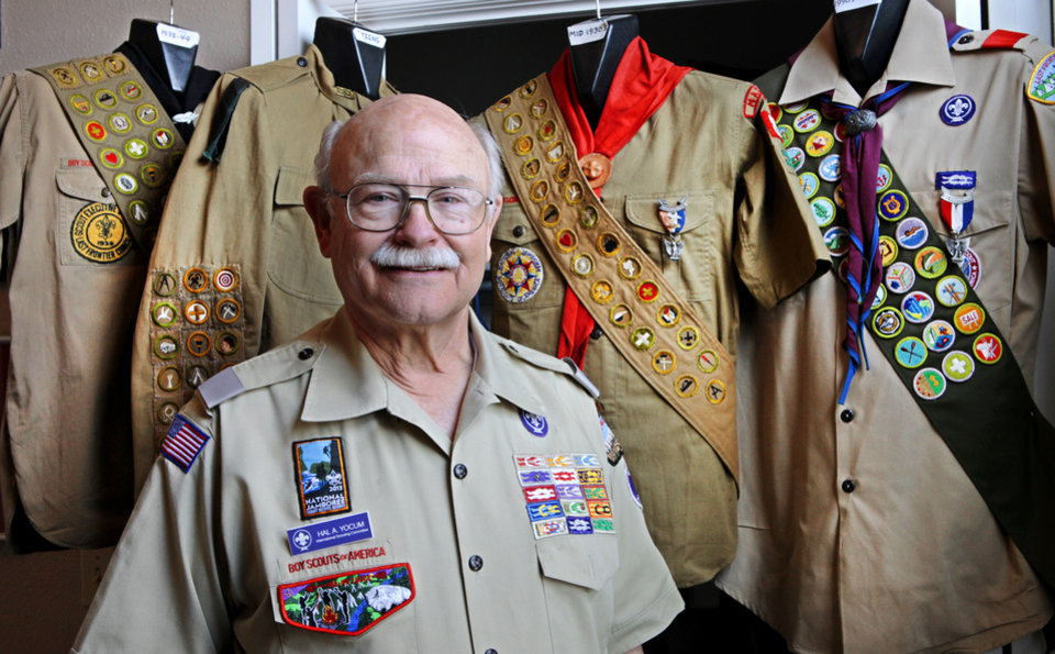Dr. Hal Yocum, an Edmond resident, has a collection of Boy Scout uniforms that spans about 100 years. Yocum brought the collection to an Eagle District Awards Banquet in February. Photo by David McDaniel, The Oklahoman