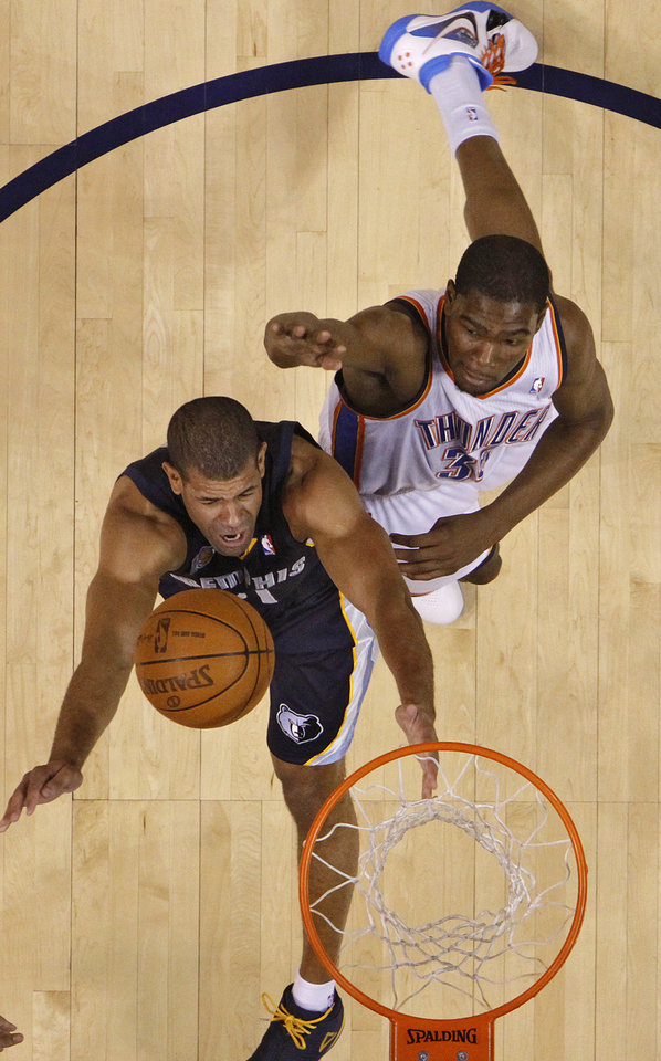Photo - Oklahoma City's Kevin Durant (35) battles against Memphis' Shane Battier (31) during game one of the Western Conference semifinals between the Memphis Grizzlies and the Oklahoma City Thunder in the NBA basketball playoffs at Oklahoma City Arena in Oklahoma City, Sunday, May 1, 2011. Photo by Chris Landsberger, The Oklahoman