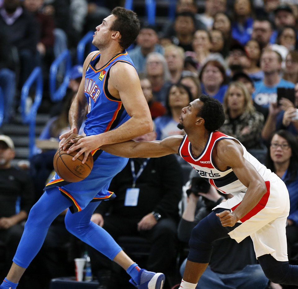 Photo - Washington's Ish Smith (14) tries to steal the ball from Oklahoma City's Danilo Gallinari (8) in the fourth quarter during an NBA basketball game between the Oklahoma City Thunder and the Washington Wizards at Chesapeake Energy Arena in Oklahoma City, Friday, Oct. 25, 2019. The Wizards won 97-85. [Nate Billings/The Oklahoman]