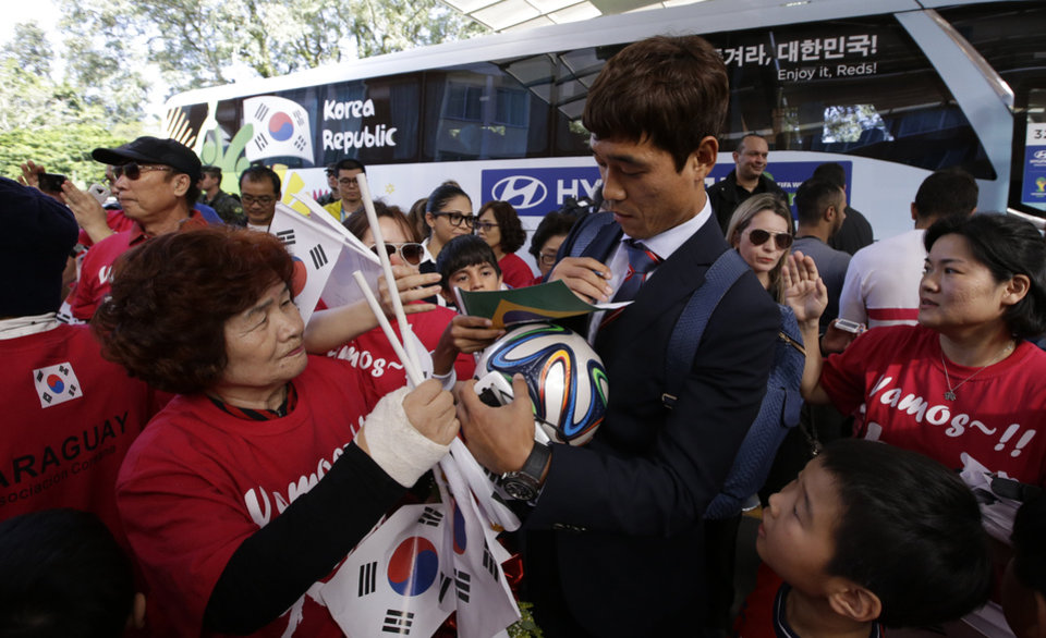 Photo - South Korea's national soccer team player Park Chu-young signs autographs for fans upon the team's arrival at the team hotel in Foz do Iguacu, Brazil, Wednesday, June 11, 2014. South Korea play in group H of the 2014 soccer World Cup. (AP Photo/Lee Jin-man)