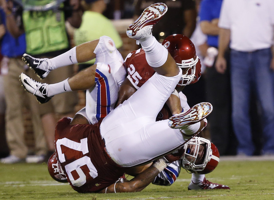 Photo - Louisiana Tech running back Blake Martin is tackled by Oklahoma defensive lineman Charles Walker (97) and linebacker Aaron Franklin (25) during the third quarter of an NCAA college football game in Norman, Okla., Saturday, Aug. 30, 2014. Oklahoma won 48-16. (AP Photo/Sue Ogrocki)