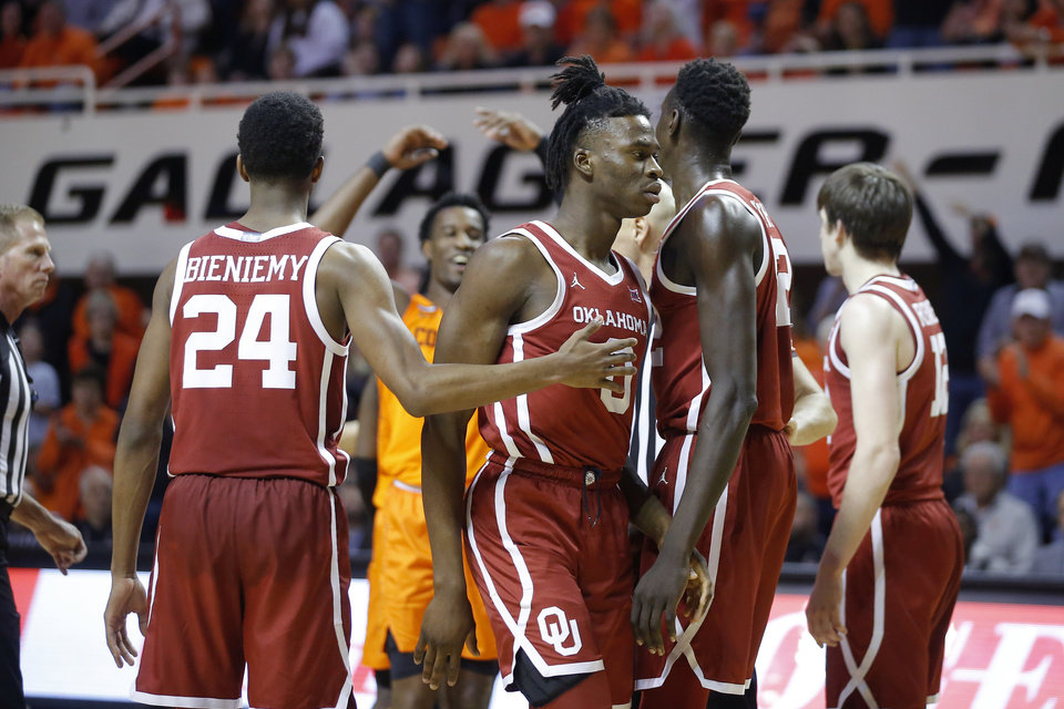 Photo - Oklahoma's Victor Iwuakor (0) walks away from Jamal Bieniemy (24) as Oklahoma State's Cameron McGriff (12) raises his arms after a foul on Oklahoma late in an NCAA men's Bedlam basketball game between the Oklahoma State University Cowboys (OSU) and the University of Oklahoma Sooners (OU) at Gallagher-Iba Arena in Stillwater, Okla., Saturday, Feb. 22, 2020. Oklahoma State won 83-66. [Bryan Terry/The Oklahoman]