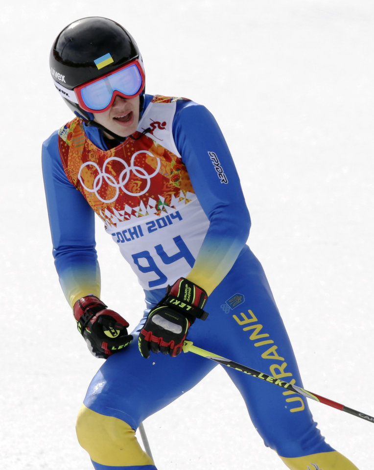 Photo - Ukraine's Dmytro Mytsak finishes the first run of the men's giant slalom at the Sochi 2014 Winter Olympics, Wednesday, Feb. 19, 2014, in Krasnaya Polyana, Russia. (AP Photo/Gero Breloer)