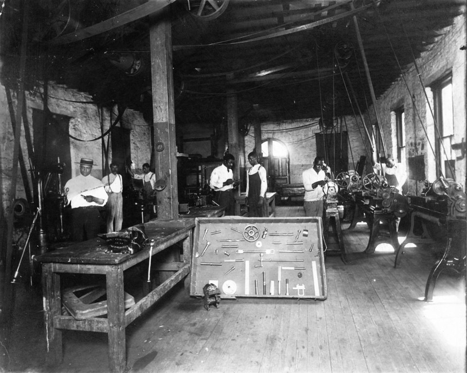 Photo - Langston University The photo shows one of the early industrial shop classes at Langston University. The college started with four teachers, 41 students and 40 acres of land. Within eight years, it had grown to 15 teachers, 160 acres and a main building that could hold 500 students. The university's fortunes wavered over the years, but it is now a vital school with a student population of about 4,000.  The Melvin B. Tolson Black Heritage Center, established in 1970, holds more than 7,000 volumes, a collection of artifacts and other materials. Its three major research areas are African history, black history in the U.S. and blacks in the humanities and arts.  In part, it owes its existence to Ernest Holloway, a longtime Langston University president who died in December. Holloway instructed campus recruiters to keep an eye out for items of historical significance. That effort built the collection at the Heritage Center.   The university is renowned for its work with goats. The E (Kika) de la Garza Institute for Goat Research raises and studies Angora, meat and cashmere goats on pastureland away from the actual campus. The Oklahoman Archives