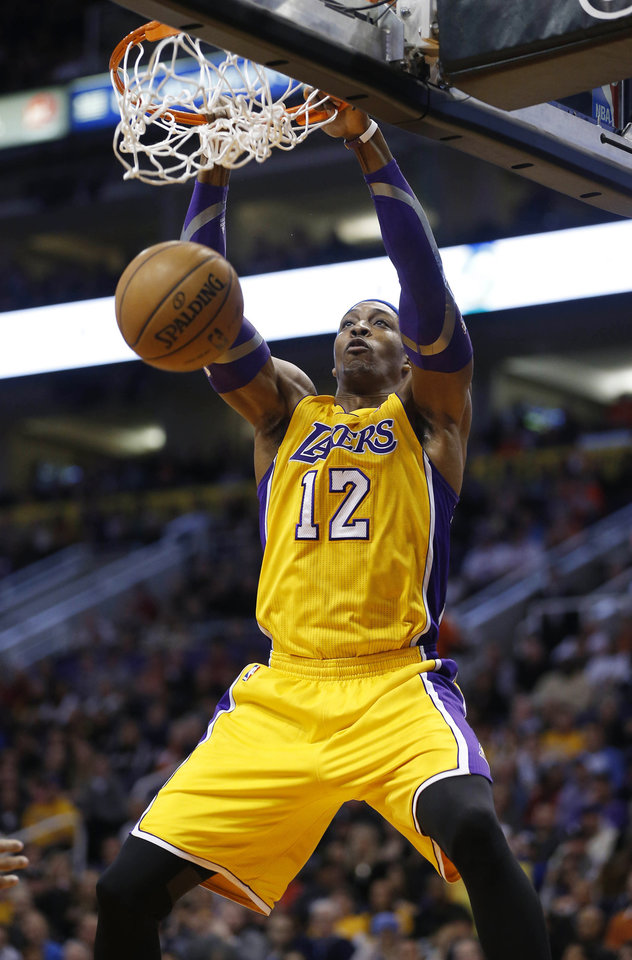 Los Angeles Lakers' Dwight Howard dunks against the Phoenix Suns during the first half on an NBA basketball game, Wednesday, Jan. 30, 2013, in Phoenix. (AP Photo/Matt York)