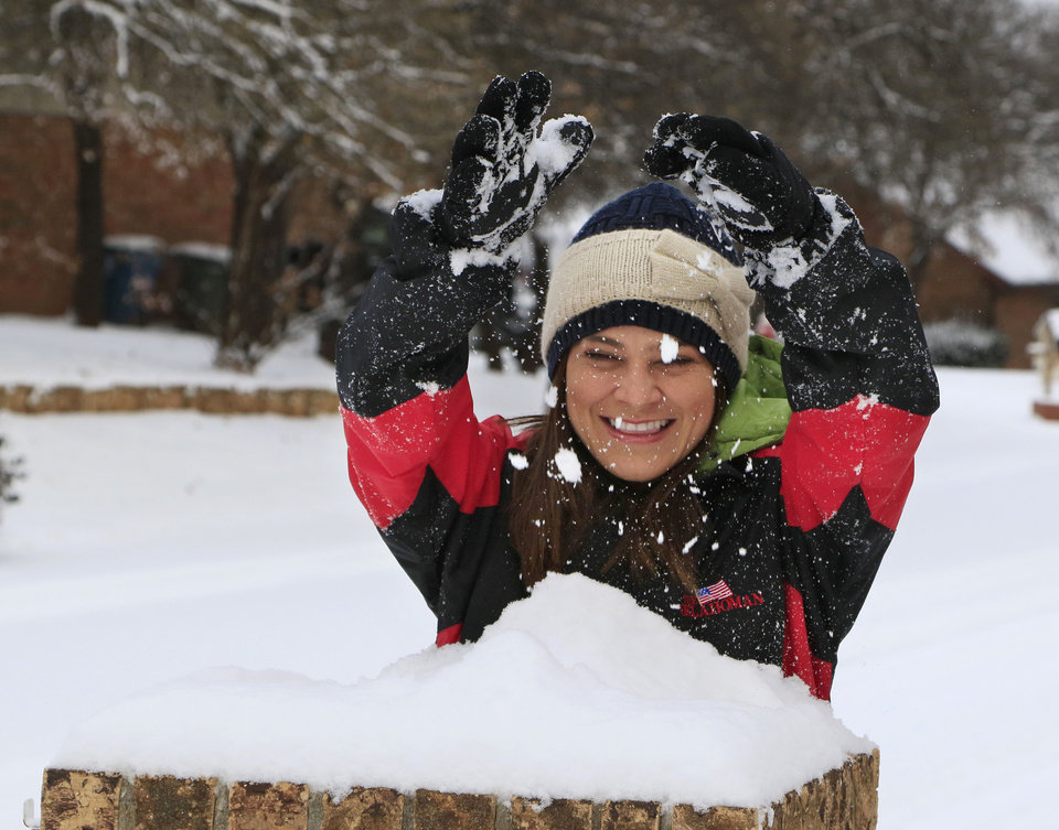 Photo - Costa Rican resident Noelia Vega experiences her first snow as a snowstorm dumps several inches in Edmond, Okla. Friday, Jan. 6, 2017.  Photo by Paul Hellstern, The Oklahoman