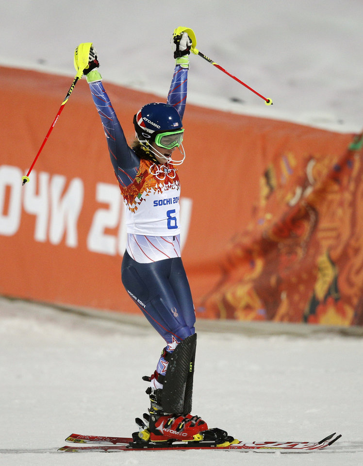 Photo - Gold medal winner Mikaela Shiffrin of the United States celebrates as she finishes the second run of the women's slalom at the Sochi 2014 Winter Olympics, Friday, Feb. 21, 2014, in Krasnaya Polyana, Russia.(AP Photo/Christophe Ena)