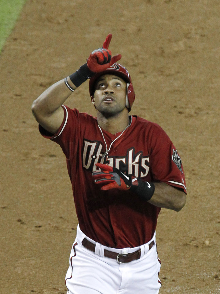 Photo -   Arizona Diamondbacks' Chris Young points skyward as he rounds the bases after hitting a three-run home run against the Houston Astros in the sixth inning during a baseball game on Sunday, July 22, 2012, in Phoenix.(AP Photo/Ross D. Franklin)