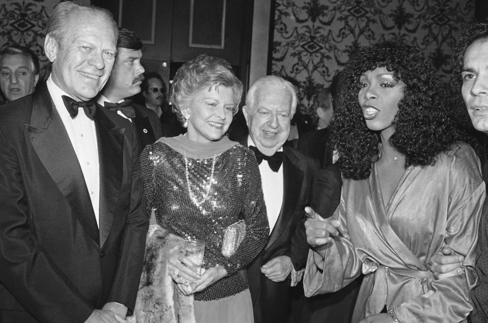 "Photo -   FILE - In this Nov. 2, 1979 file photo, Gerald and Betty Ford, left, Donna Summer, right, and Cedars-Sinai Medical Center board chairman Steve Broidy at a reception prior to gala disco party benefit in Beverly Hills, Calif. Summer, the Queen of Disco who ruled the dance floors with anthems like ""Last Dance,"" ""Love to Love You Baby"" and ""Bad Girl,"" has died. Her family released a statement, saying Summer died Thursday, May 17, 2012. She was 63. (AP Photo/Reed Saxon, File)"