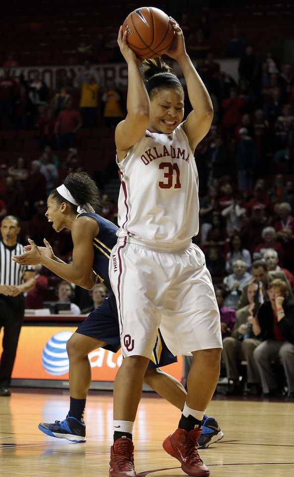 Photo - Oklahoma forward Portia Durrett (31) reacts in front of West Virginia forward Averee Fields (5) after OU missed a tying free throw during the women's basketball game between, University of Oklahoma and West Virginia, Thursday, Feb. 13, 2014, in Norman, Okla. Photo by Sarah Phipps, The Oklahoman